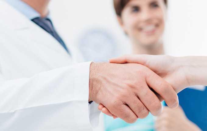 A close-up image of a handshake.