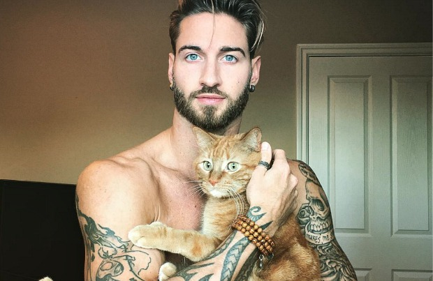 Travis DesLaurier and his cat Jacob