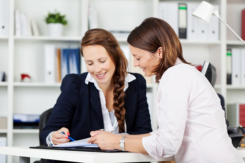 Two women preparing a financial plan