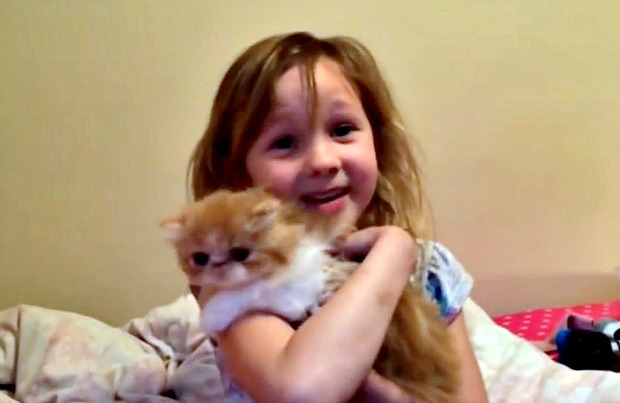 Brooklyn holding her new kitten Max