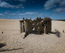The ruins of a miniature golf castle peak out of the dunes of Jockeys Ridge in Nags Head, North Carolina.