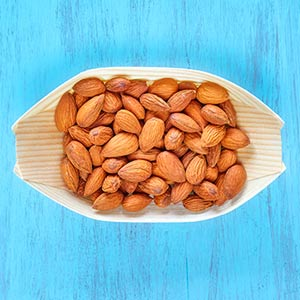 bowl of almonds, almonds and dogs