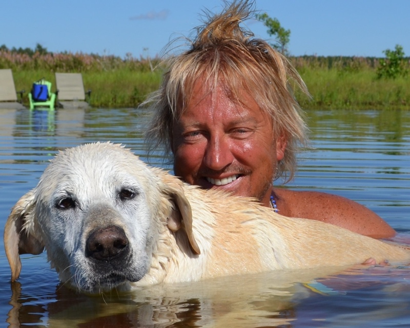 Mark Lacek and his dog Darby in the Lake