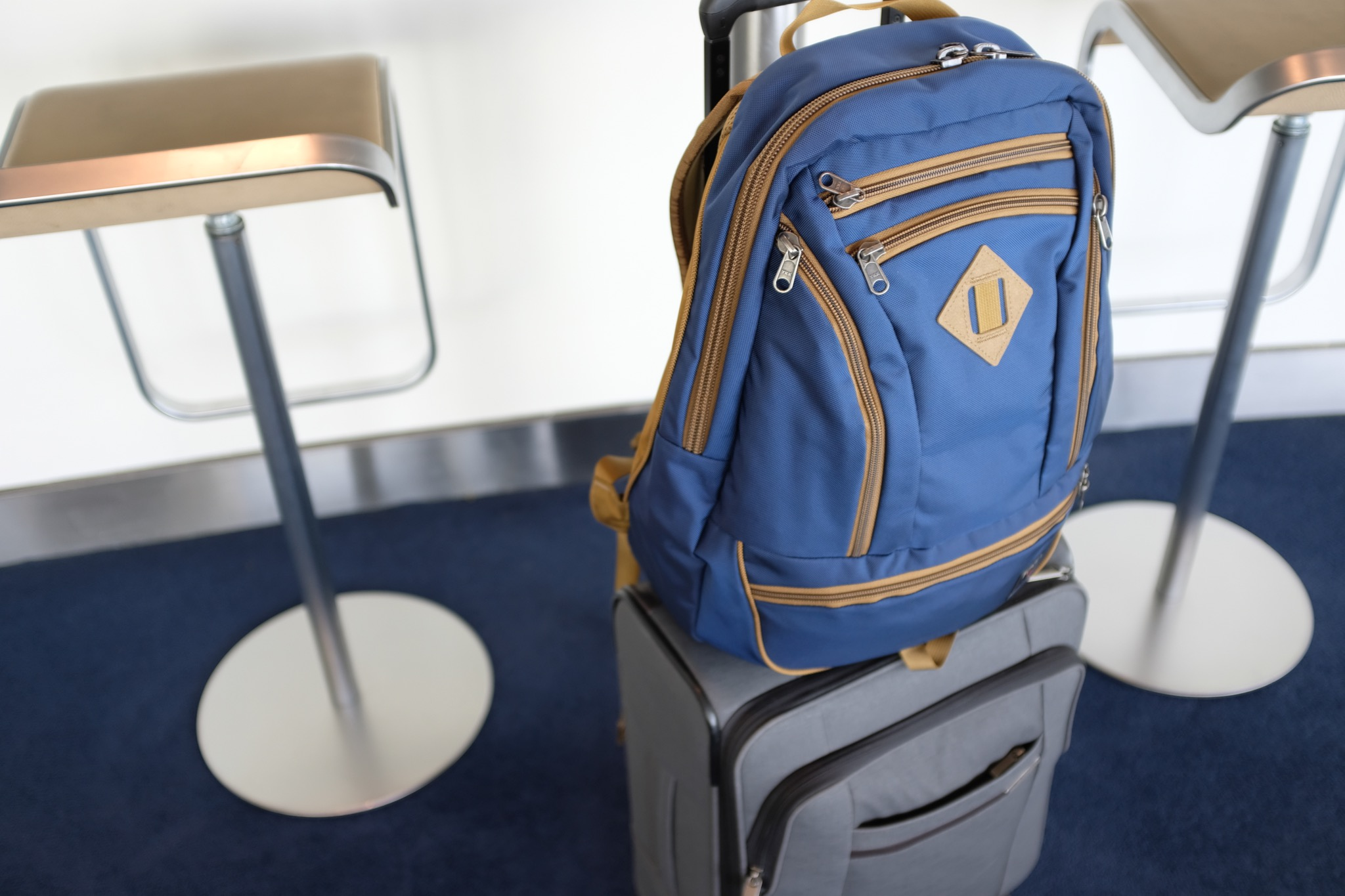 The Guide's Edition sits perfectly on a rolling bag, however it doesn't have any luggage handle straps