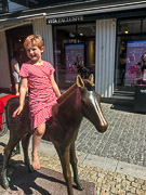 """Ayla riding a """"horse"""" in Kristiansand."""