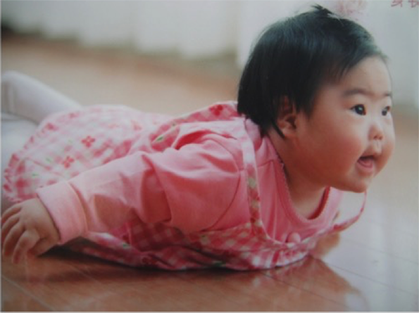 trisomy-21-baby-yuuki on the floor