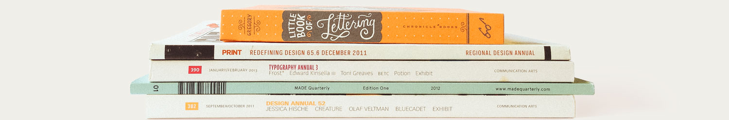 A stack of typography books