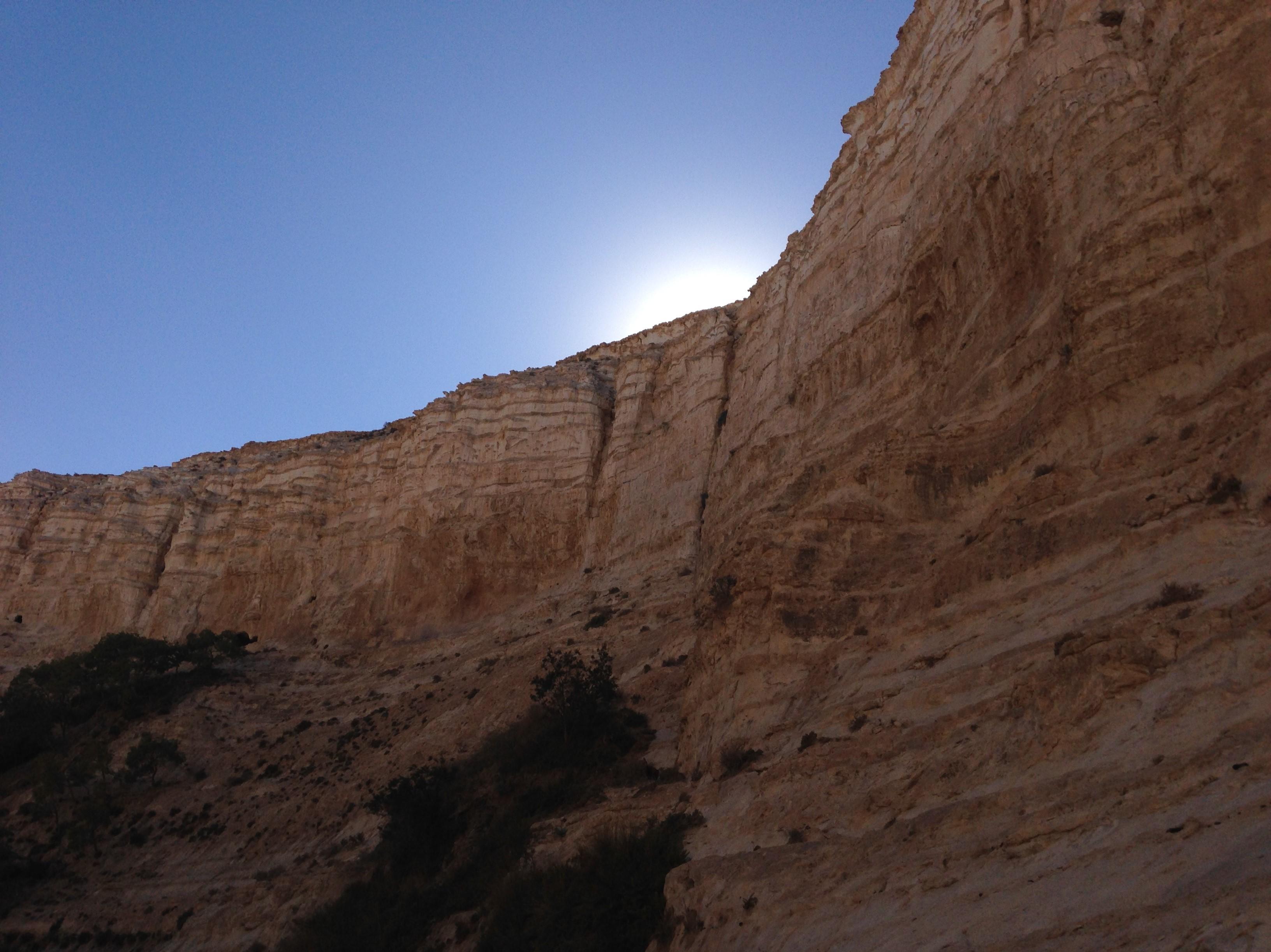 sun over wall in desert