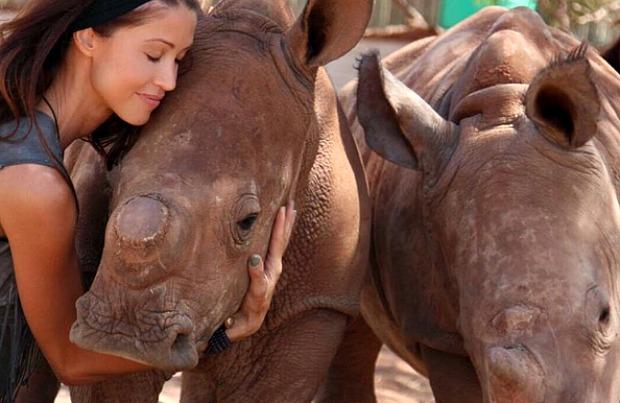 Shannon Elizabeth hugs rhinos in Africa