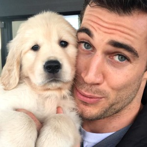 Dr. Evan Antin cuddles with a puppy