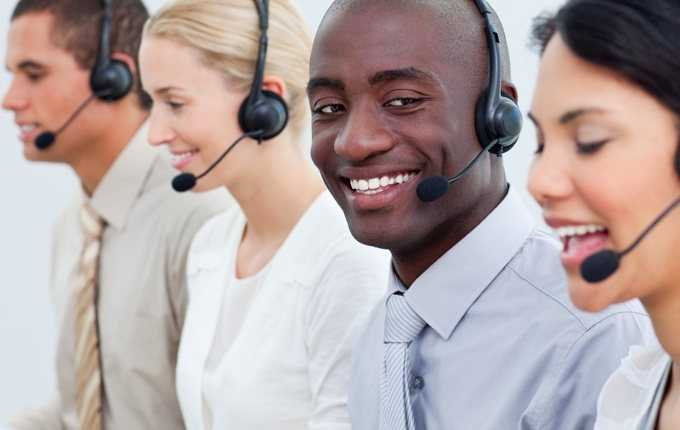 A group of professionals wearing headsets.