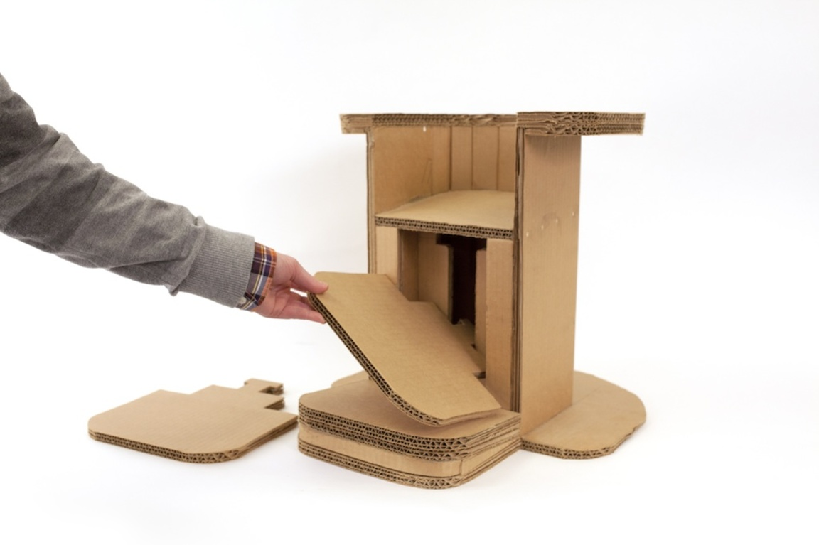 A cardboard chair from Perkins School for the Blind, with adjustable foot rests for customized support.