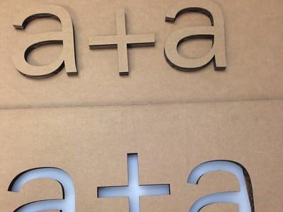 a cardboard cutout for a + a