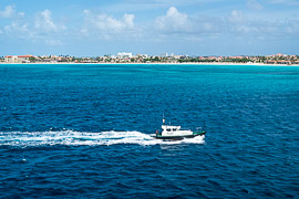A pilot boat prepares to escort our cruise ship into port in Aruba. Caribbean Ocean, west of Aruba, 2017