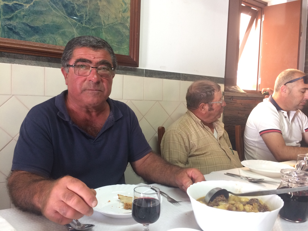 João Correia enjoys a duck stew lunch with his friends in a local restaurant in Aldeia da Luz.