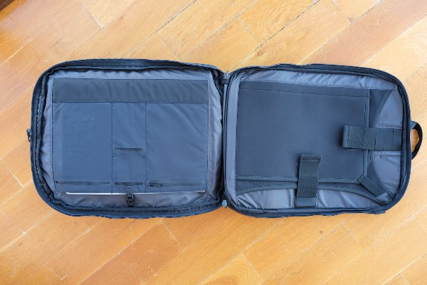 The laptop compartment can be opened flat as well. The left side is for storing documents and the right side is for storing your laptop & tablet.