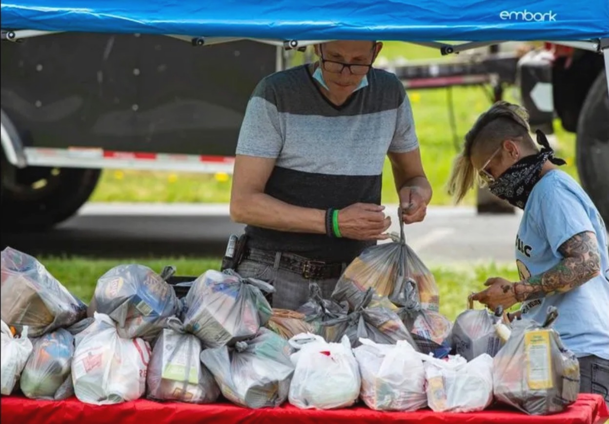 food distribution table holding bags of groceries