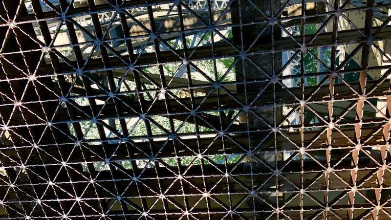 Looking through the grate in the bridge at the Columbia River