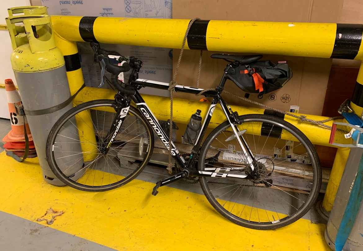 My bike lashed to a pole on the car deck