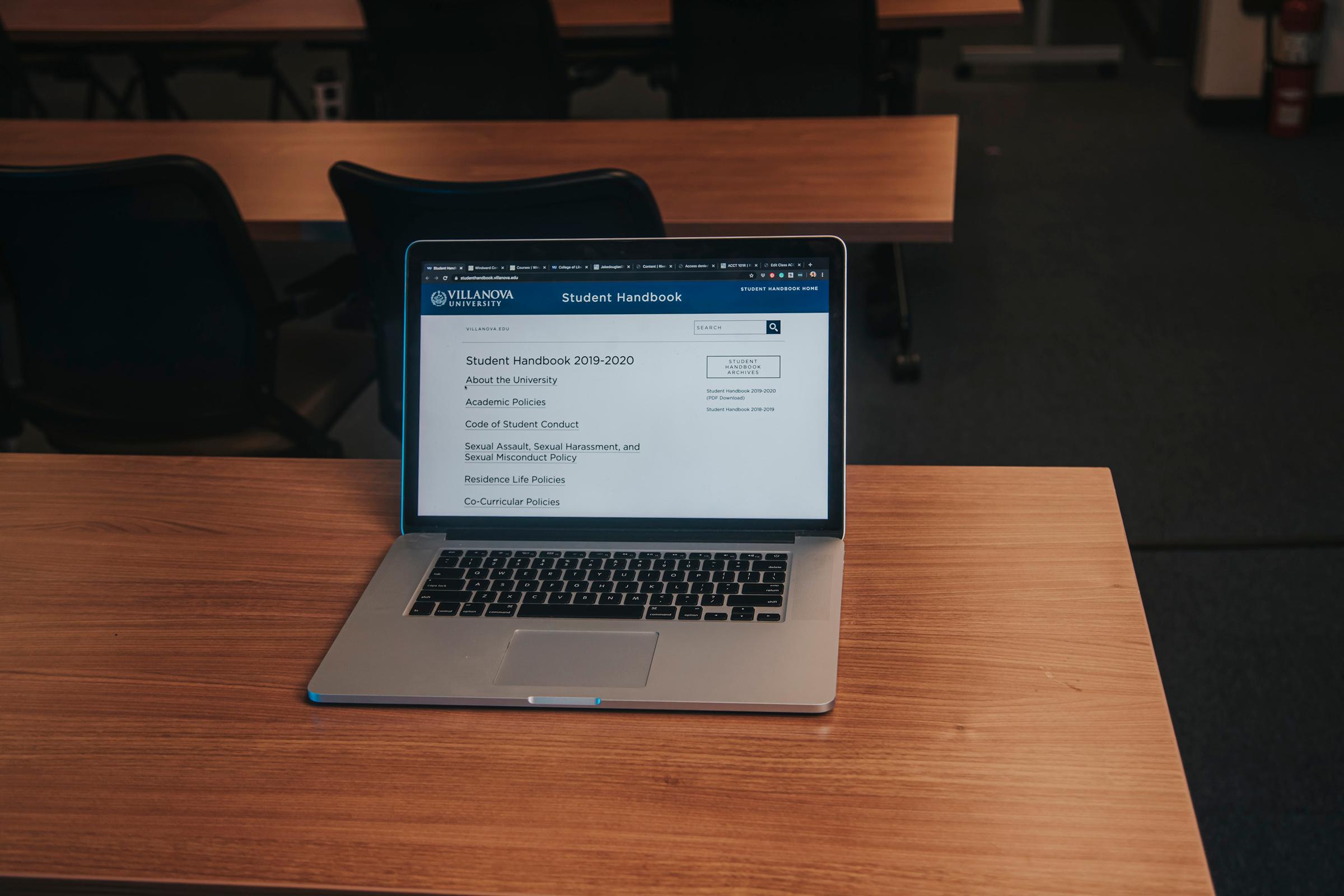 a laptop viewing student handbook software