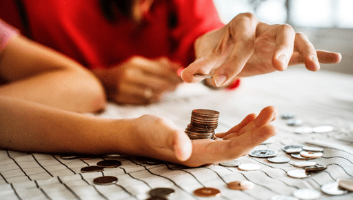Business owner putting coins into employee's hand to count #cashflow