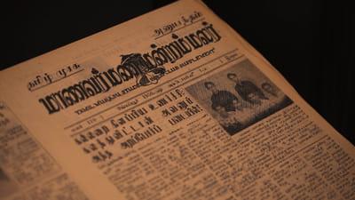A newspaper featuring the Tamil Murasu.