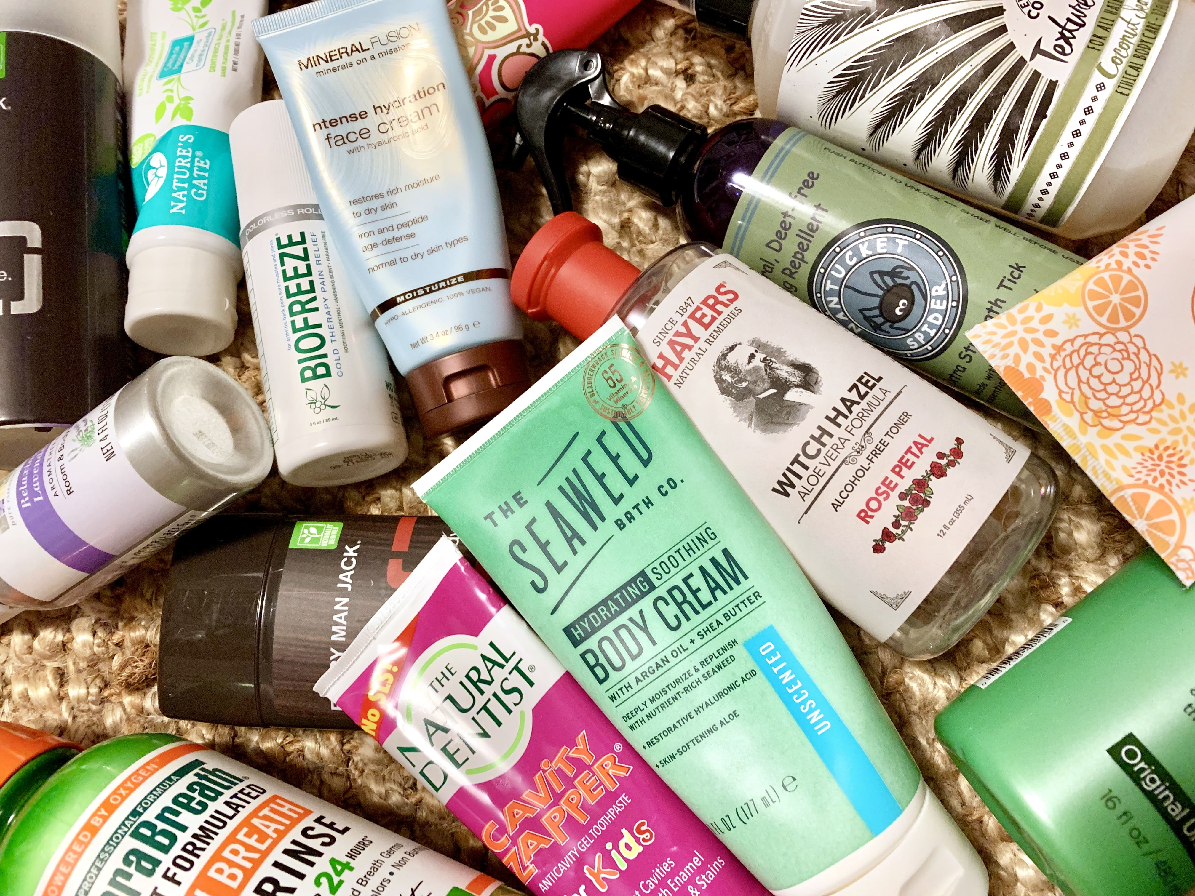 Photo of a bunch of allergy-friendly body products thrown about the floor