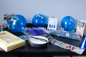 Birthday Table set up with balloons, cake, banners, cards and presents