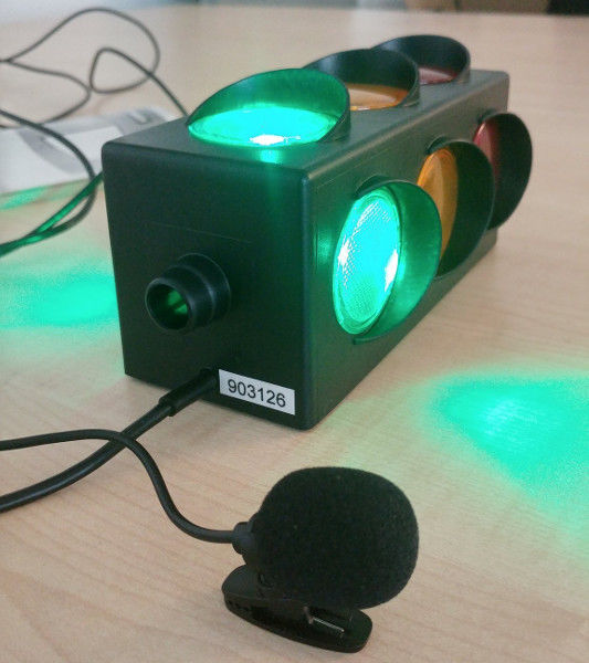 USB Traffic Light (green is on) and a microphone attached to a raspberry pi