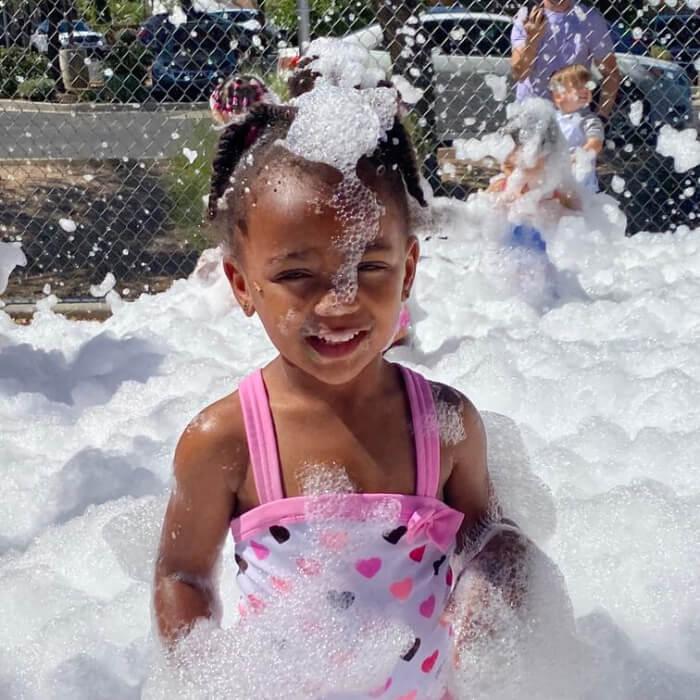 Girl playing in foam.