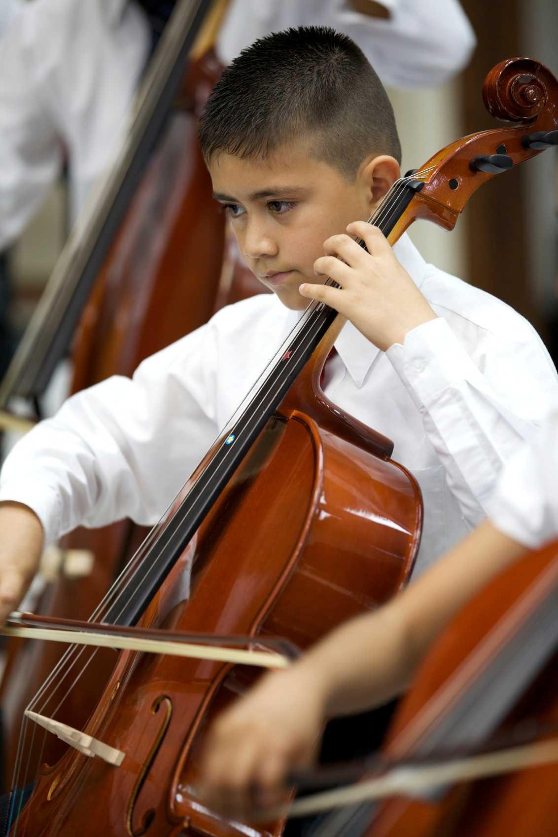 Boy playing a cello