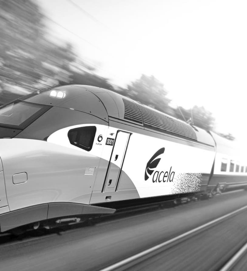 black and white photo of an acela train