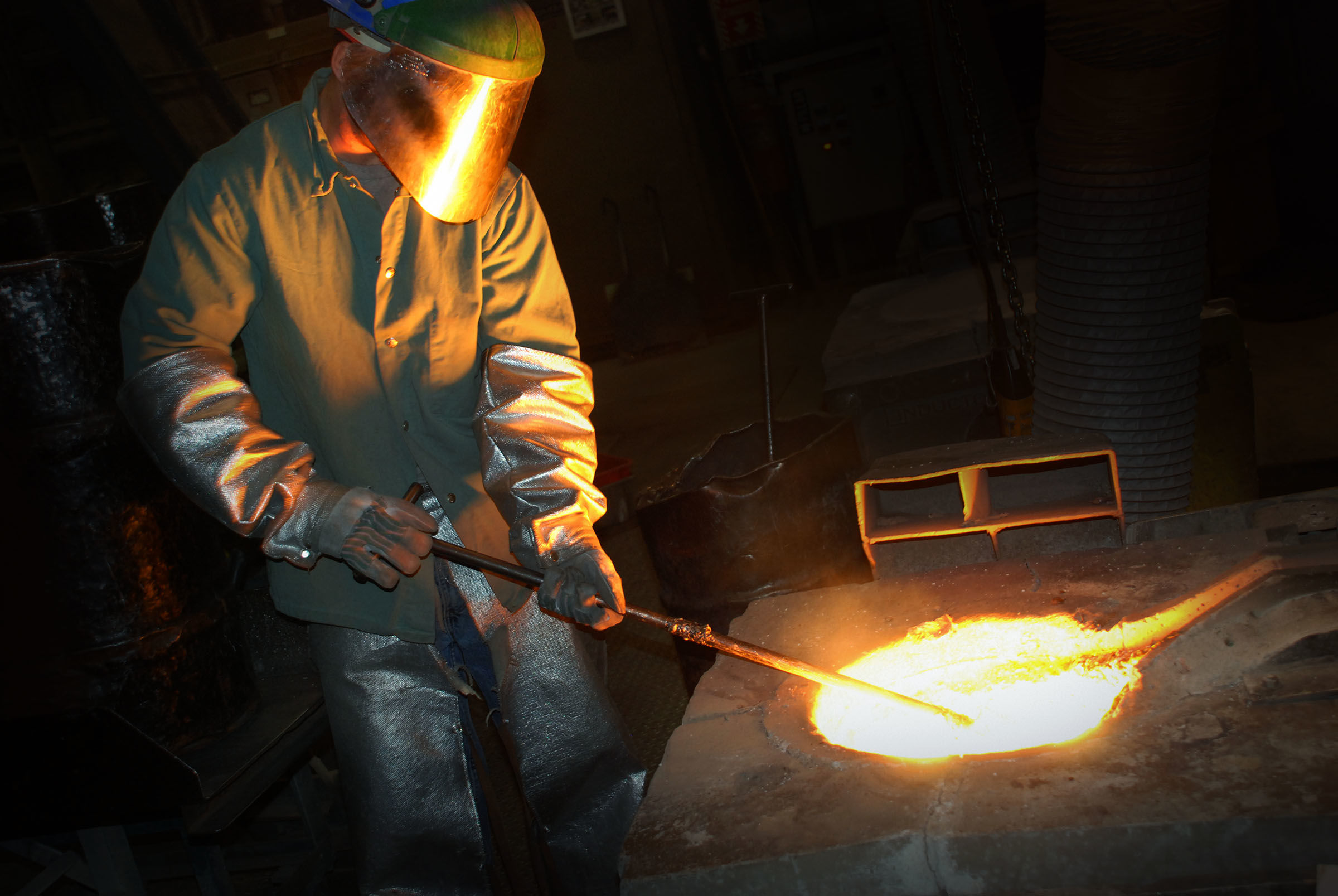 Man forming metal