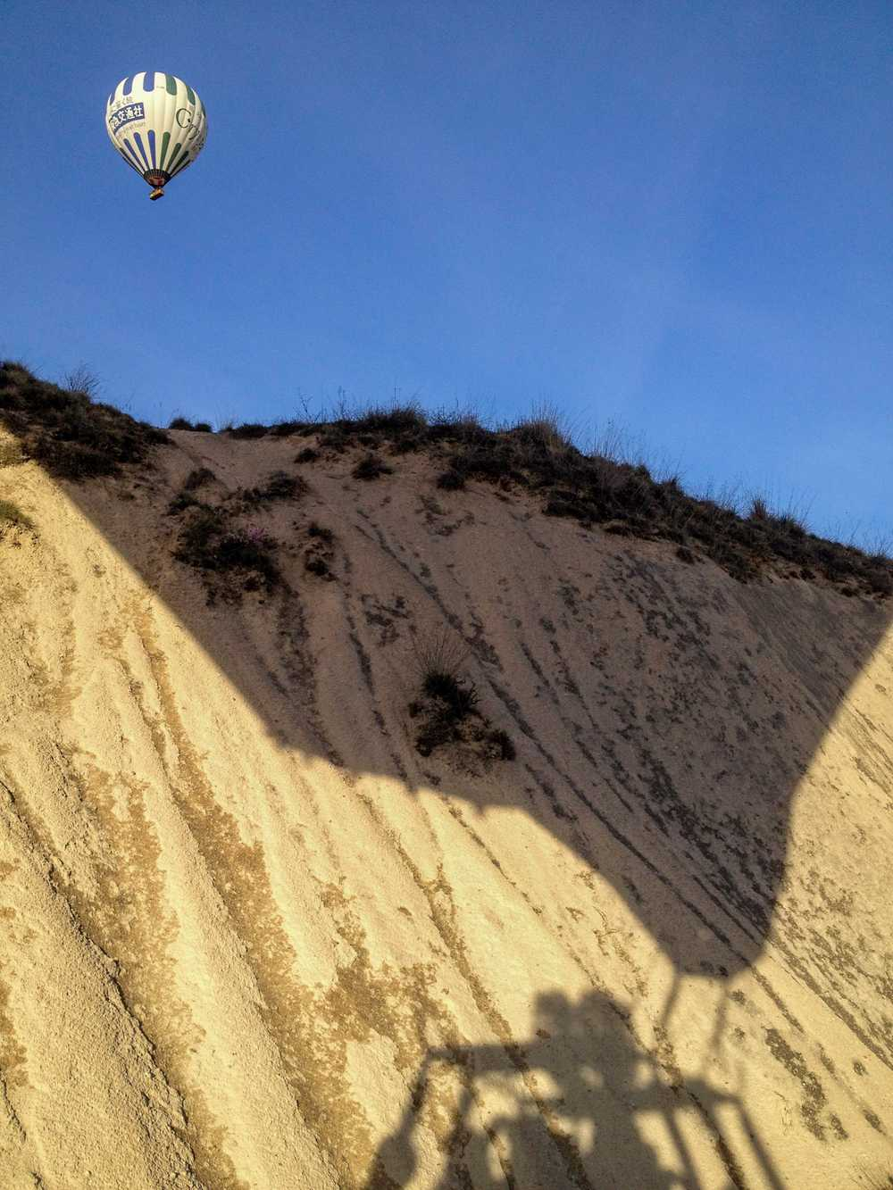 Nap-of-the-earth flying —our own shadow on the hillside