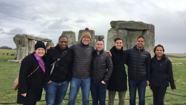 A group of people in front of Stonehenge