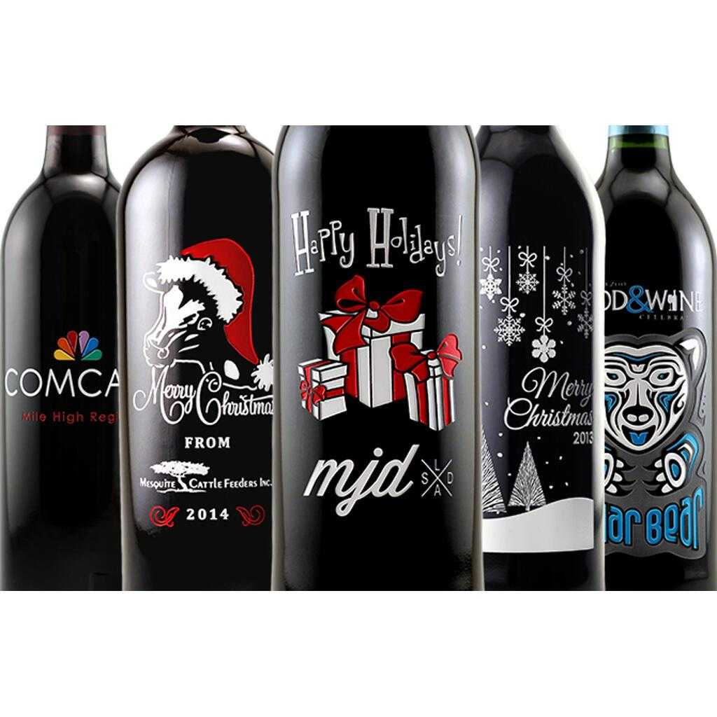 Five custom etched Happy Holidays wine gift bottles