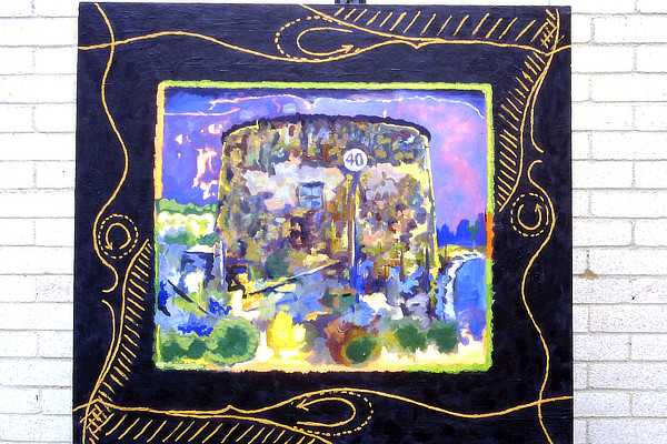 colourful painting of Martello Tower surrounded by bright illustrative border