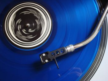 Blue Vinyl Record on Player