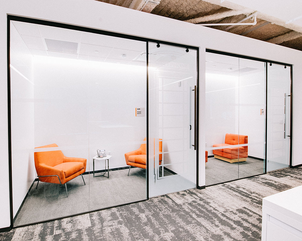 Office Lounge with Striped Glass Door and Wall