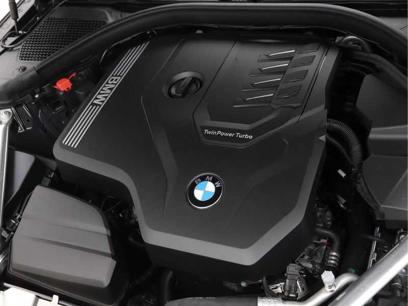 BMW 4 Serie Coupé 420i High Exe M-Sport Aut. afbeelding 12