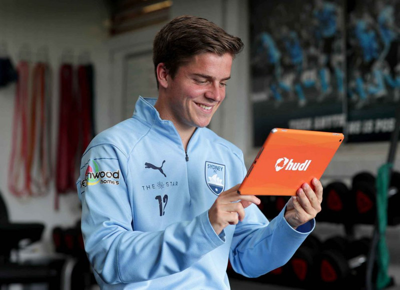 Sydney FC player watching footage on Hudl tablet