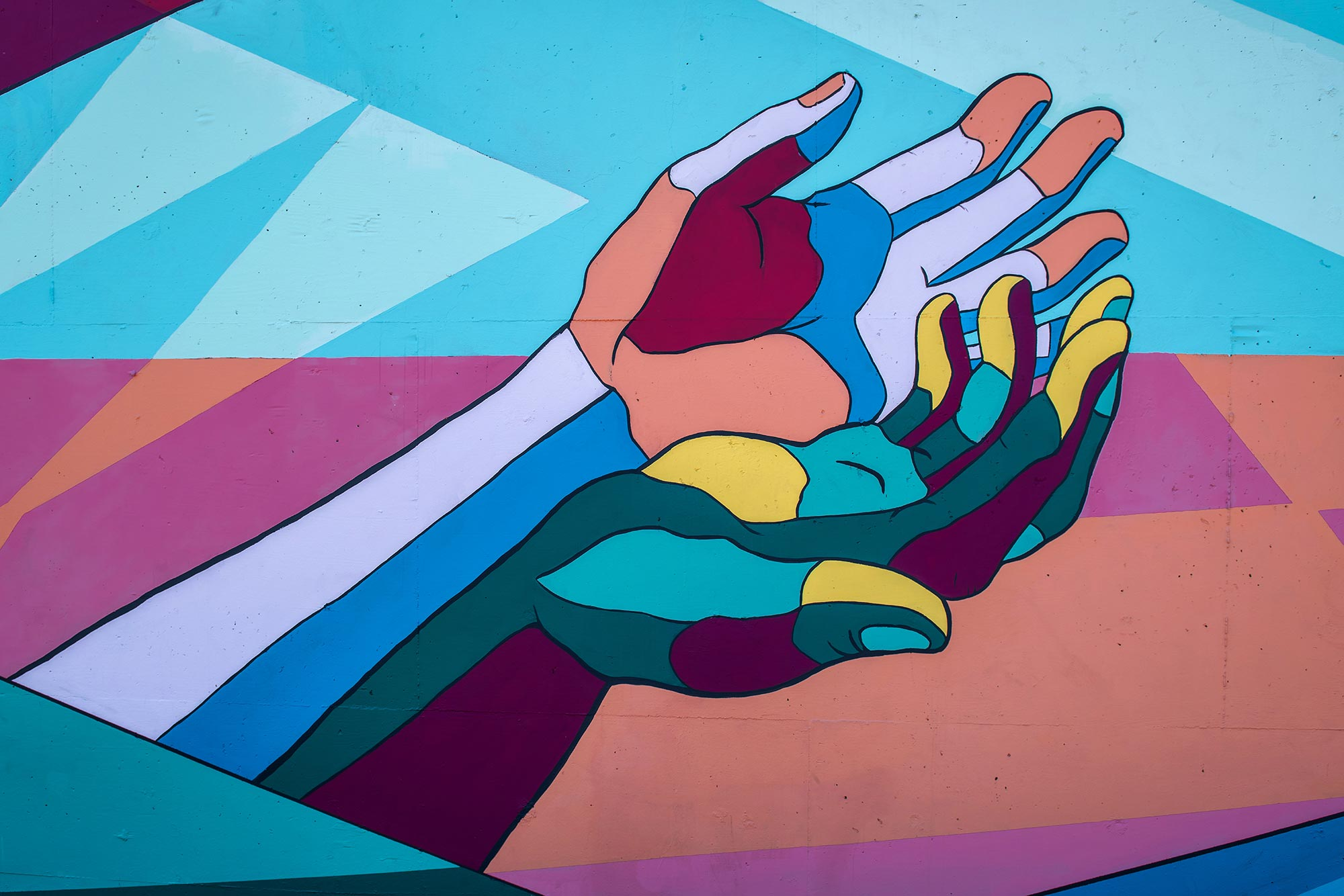 colorful mural of cupped hands.