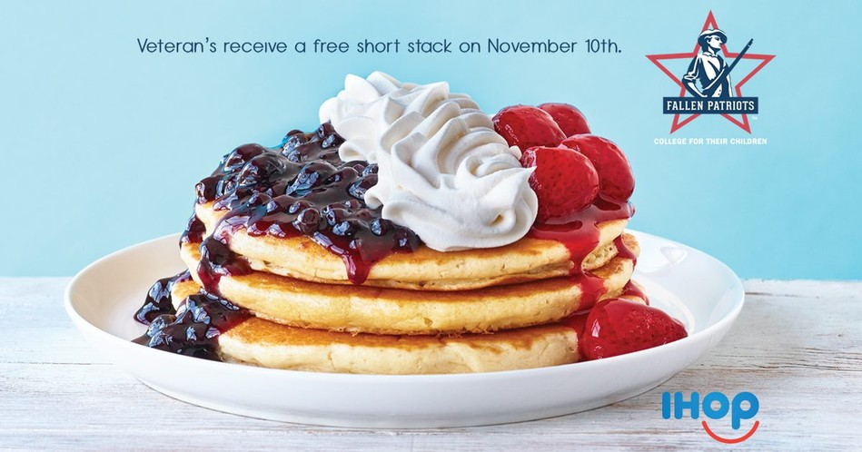 IHOP stack of pancakes with blueberries, strawberries and whip cream for veterans day