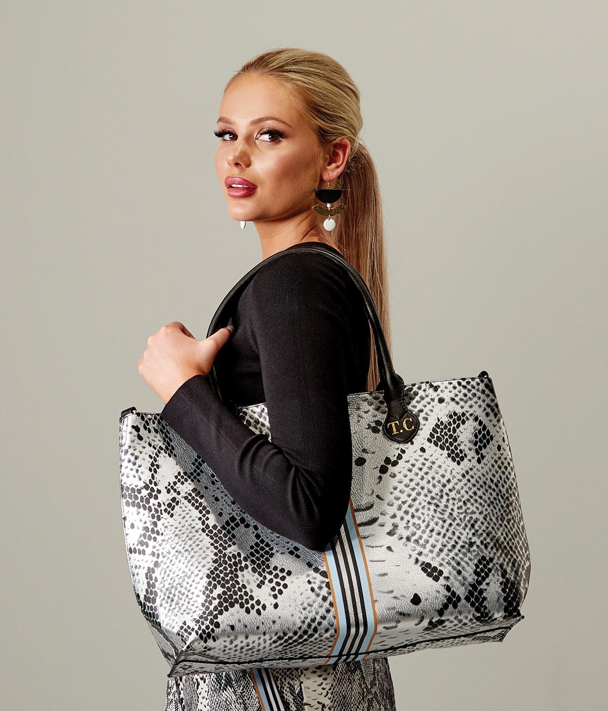 Women posing with handbag