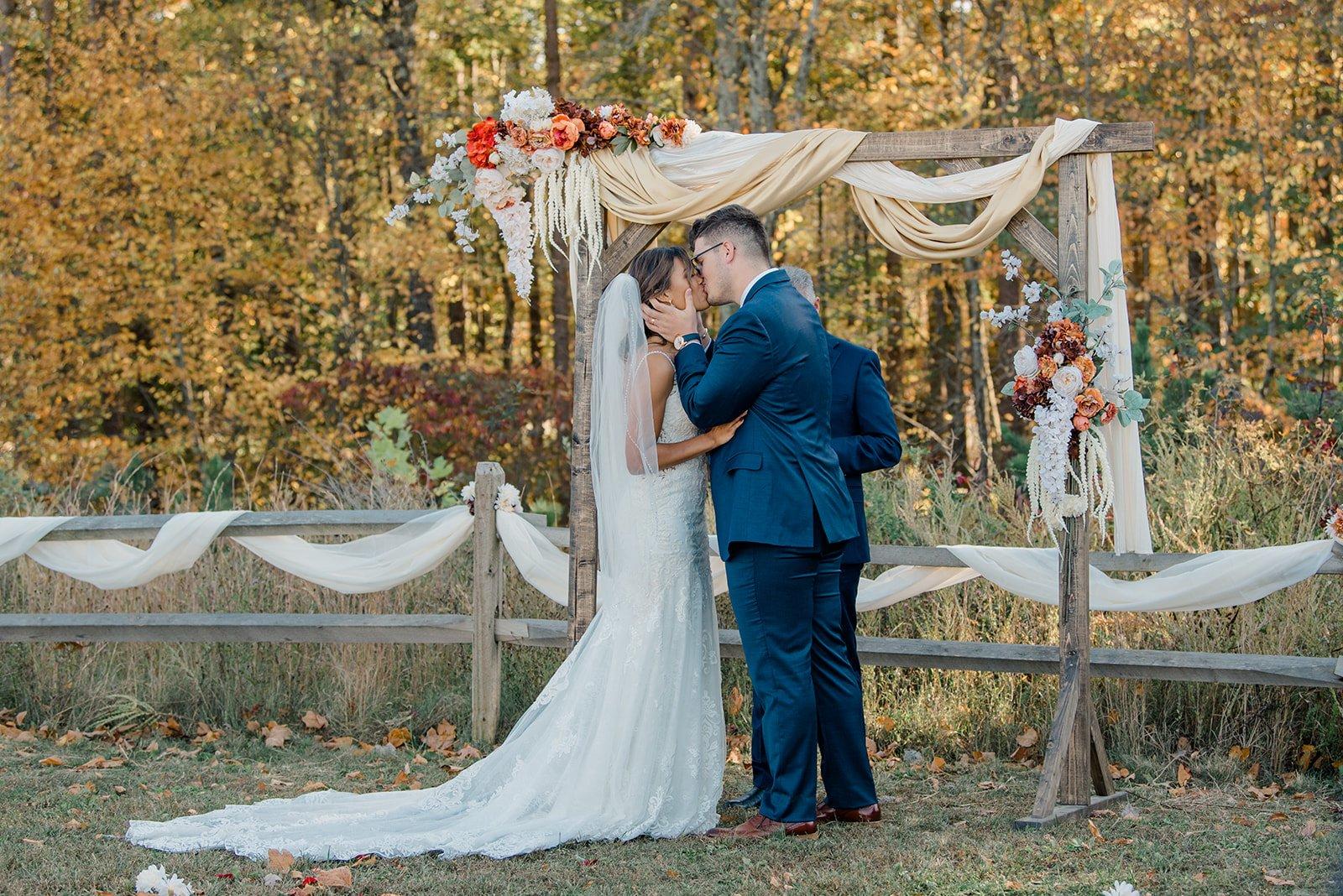 Kalika and I kissing as we become married
