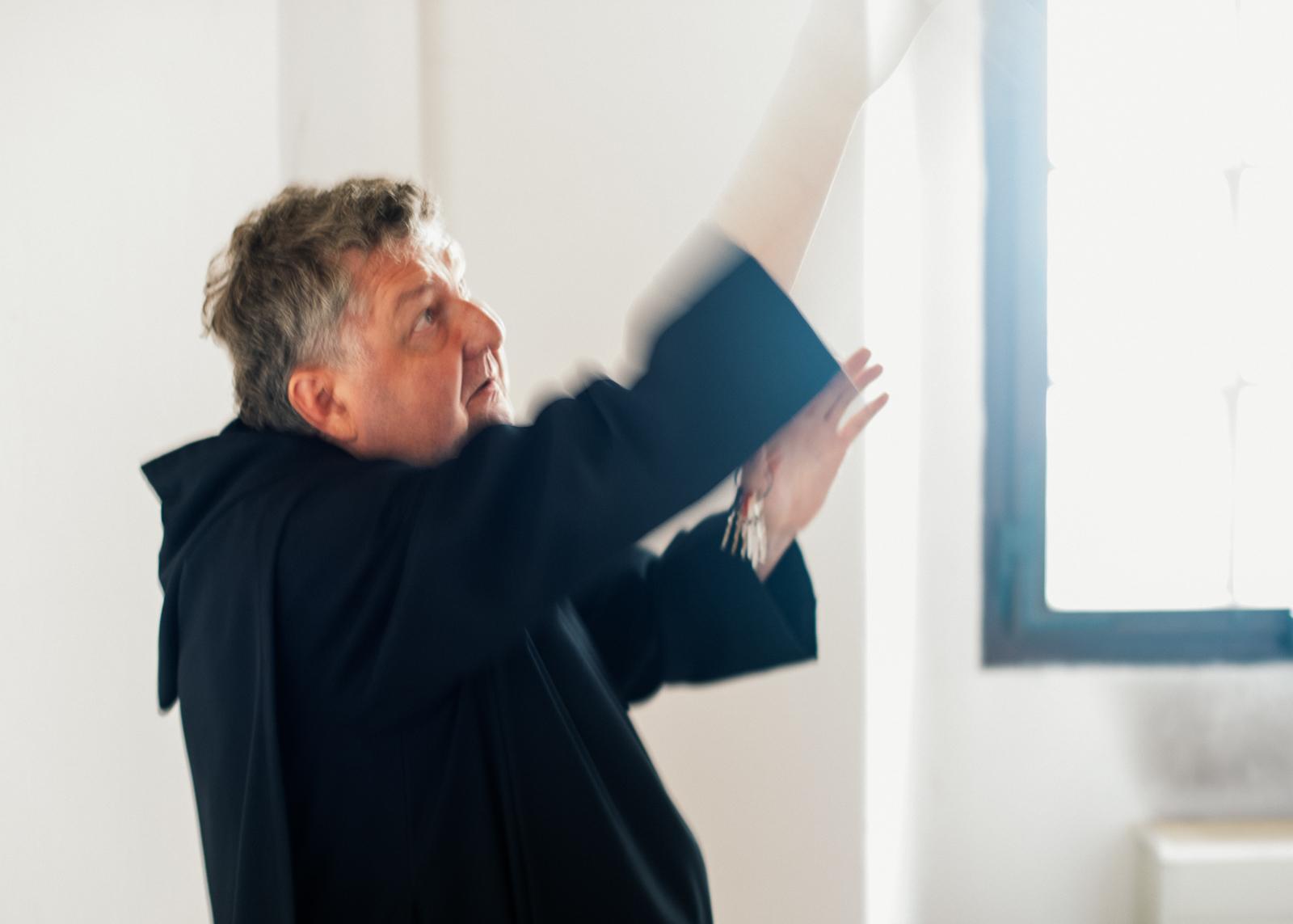 monk explaining the ceiling fresco in the monastery