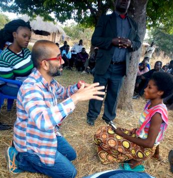 Ashish talking with a woman