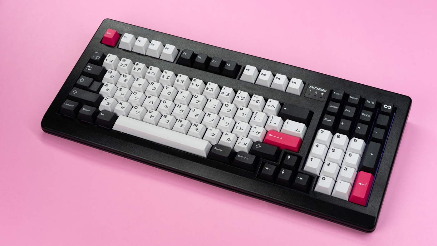 Infinikey Monochrome keycaps on a black TKC 1800 keyboard.