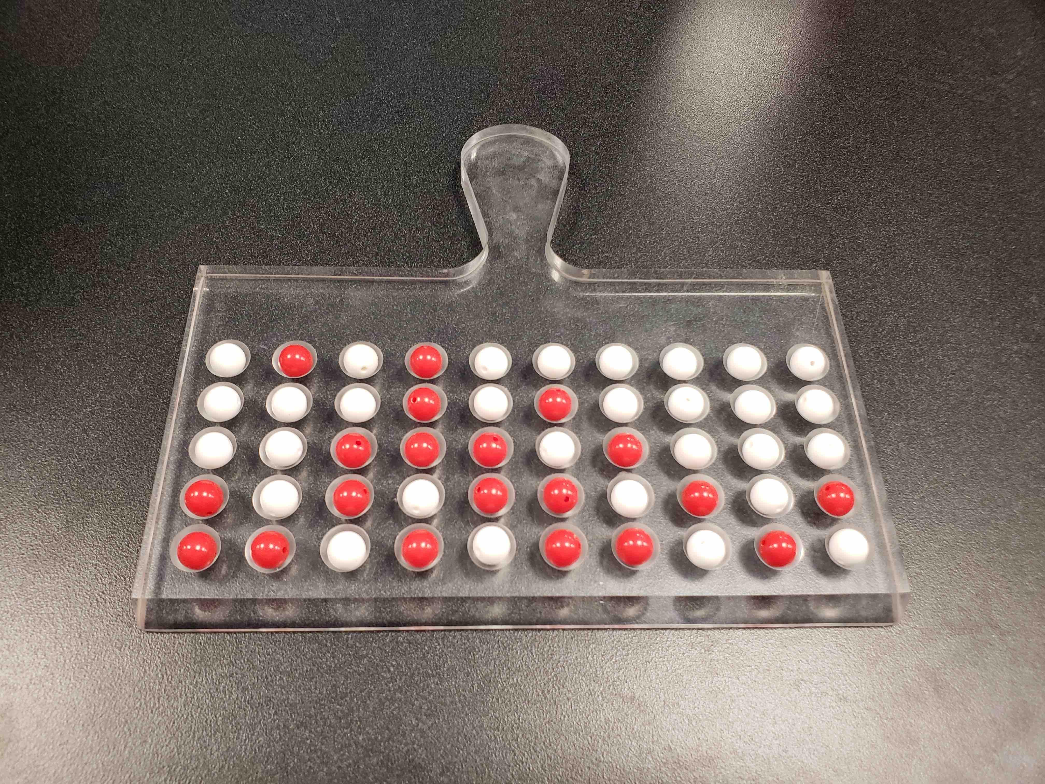 Tactile shovel for sampling n = 50 balls