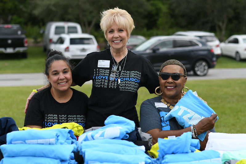 women-smiling-together-at-baptism-service-at-coastal-community-church-christian-florida